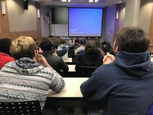 students watching speaker